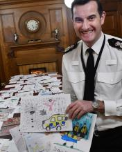 Chief Constable John Robins with wining Christmas card entry