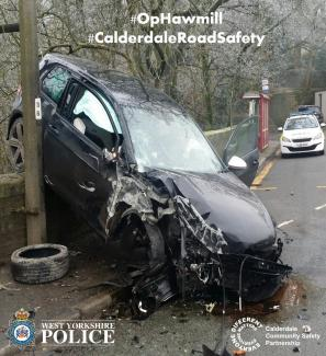 picture of a smashed up car hitting a tree