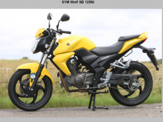 Image of stolen black and yellow motorbike