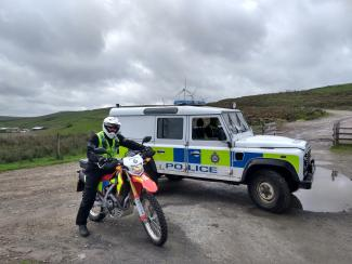 picture of a police officer on an off road bike