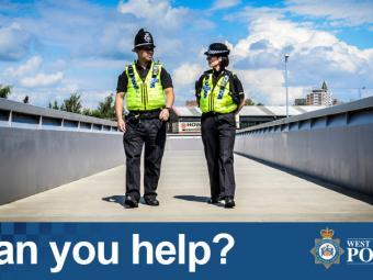 Two officers walking across a bridge